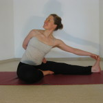 twisted seated forward bend yoga pose